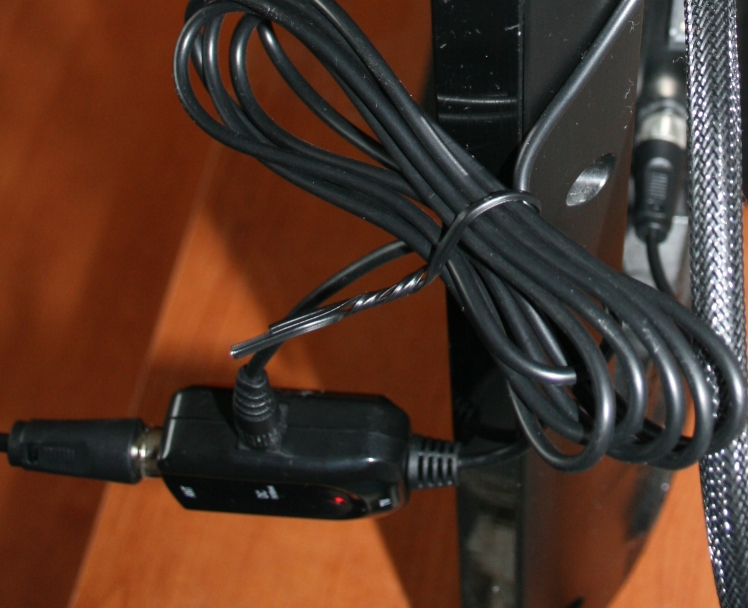 Showing the signal booster with USB cable