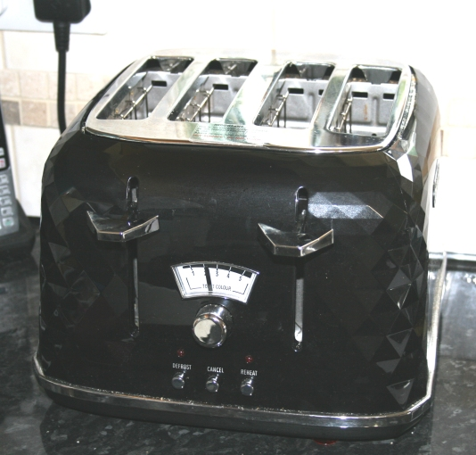 A four slice toaster which takes large bread